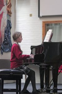 Prep girl playing the piano