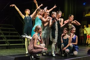 Girls on stage dressed in 1920s outfits