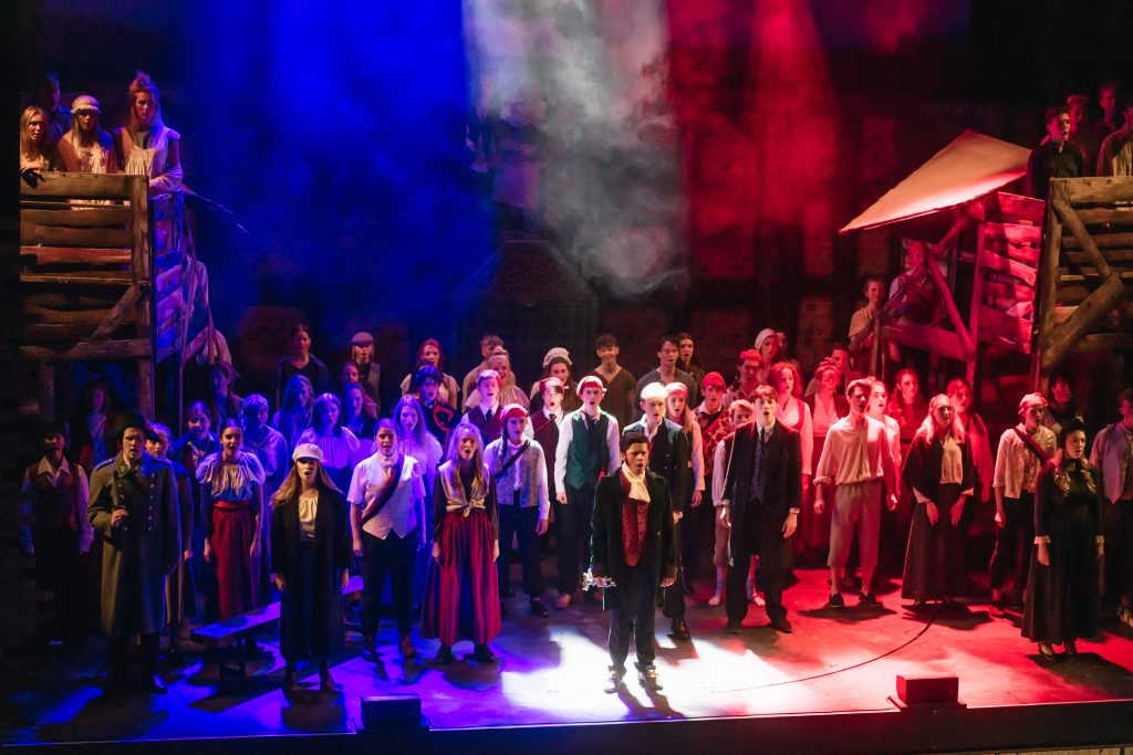 Cast of Les Mis musical on stage