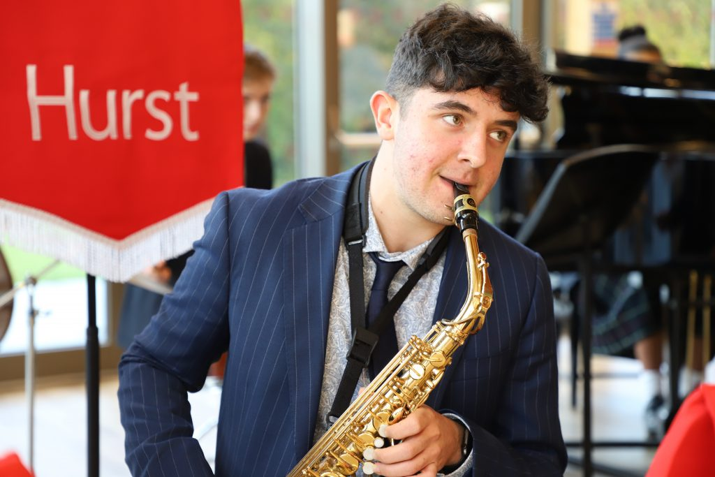 Sixth Form boy playing a saxaphone