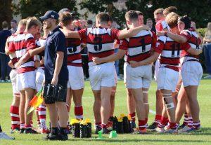 Rugby team huddling together