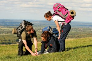 Three students reading a map on the South Downs