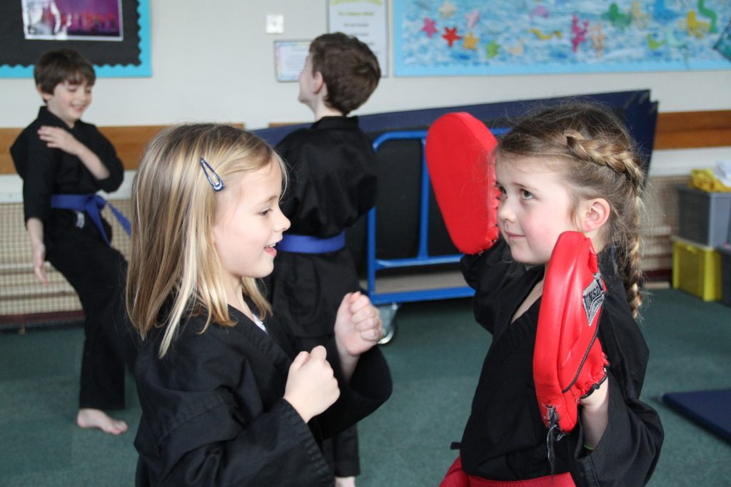 Two young girls practising their boxing skills