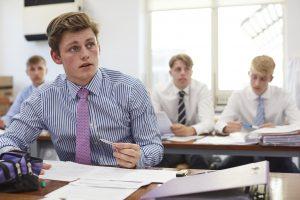 Sixth Form boy working at desk