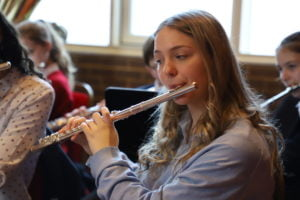 Sixth Form girl playing flute