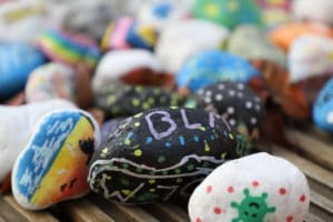 Painted stones with uplifting messages on them